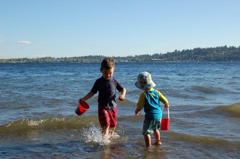 boys playing at lake
